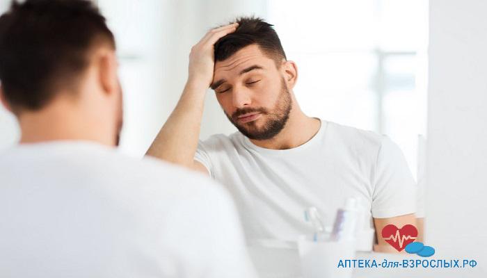 Дискомфортное состояние у мужчины из-за побочных эффектов